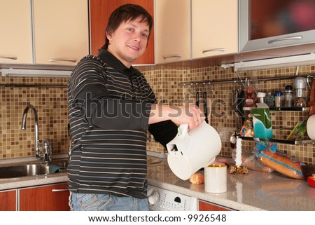 man and kettle on the kitchen