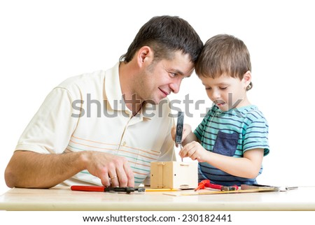 Man and kid child boy tinkering nesting box together