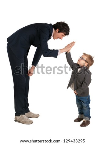 Man and little boy shake hands isolated on the white - stock photo