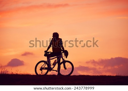 Man and mountain biking in the sunrise