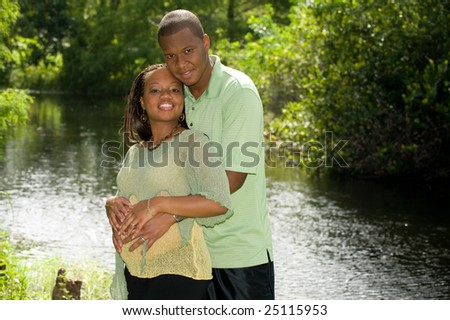 Man and Pregnant Woman Expecting Baby - stock photo