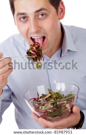 Man and salad. Focused on fork with salad - stock photo