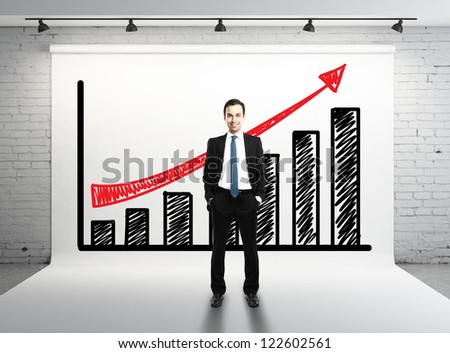 man and success graph on white backdrop - stock photo