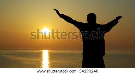 Man and sunset on the sea. Emotional scene. - stock photo