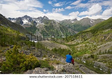 man and the mountains, Russia West Siberia, Altai mountains, Katun ridge. - stock photo
