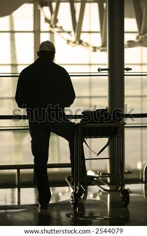 man and trolley at the airport - stock photo