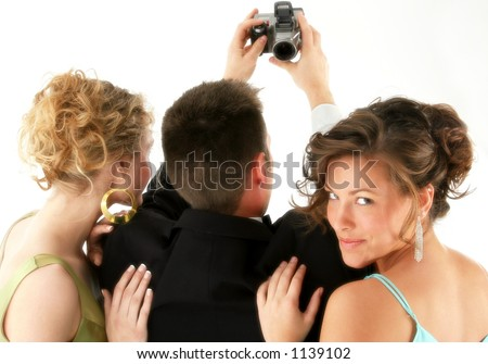 Man and two beautiful woman taking photo with digital camera. - stock photo