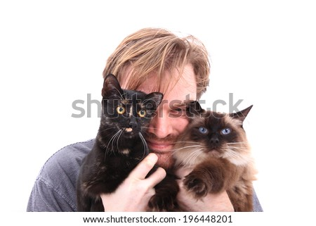 man and two cats isolated on the white background - stock photo