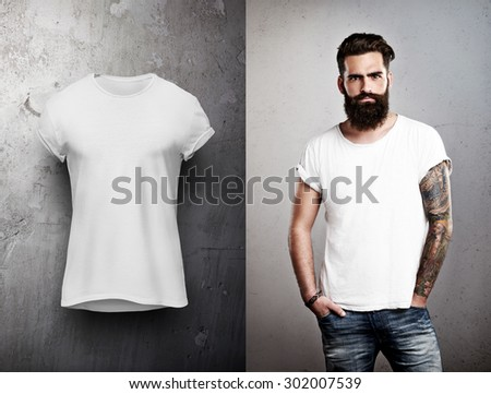 Man and white tshirt on grey background - stock photo