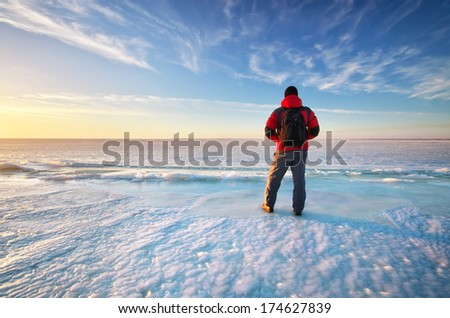 Man and winter ice. Nature composition.  - stock photo