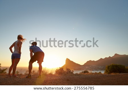 Man and woman after jogging - stock photo