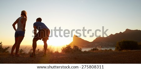 Man and woman after jogging, letterbox format - stock photo
