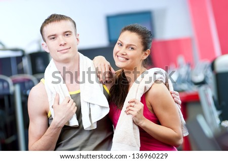 Man and woman after sport exercises. Fitness gym. - stock photo