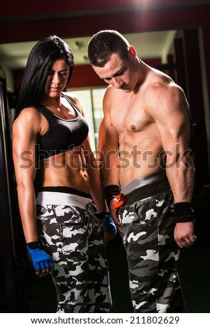 Man and woman after sport exercises. Fitness gym - stock photo