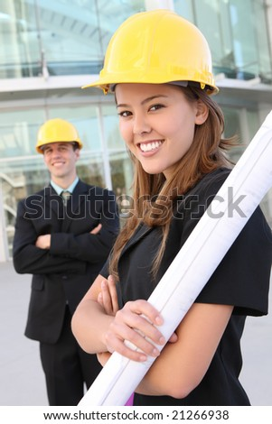 Man and woman architects on a building construction site - stock photo