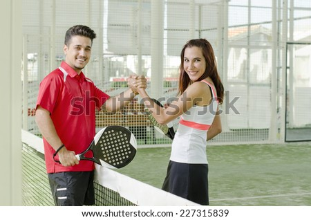 Man and woman are a paddle tennis team in mixed tournament - stock photo