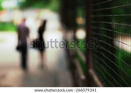 man and woman are in the park - stock photo