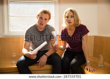 Man and woman are suffering from summer heatwave fanning themselves to stay cool - stock photo