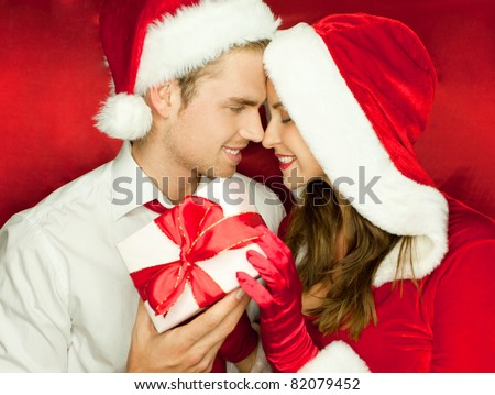man and woman at christmas - stock photo