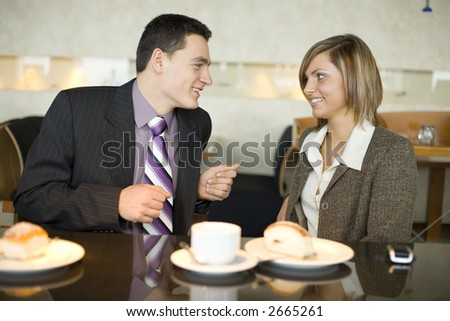 Man and Woman at Cofe Table. Short Depth of Focus (On Their Faces). - stock photo
