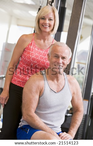 Man And Woman At Gym Together - stock photo
