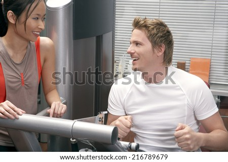 Man and woman at the gym. - stock photo