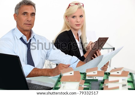 Man and woman at work - stock photo