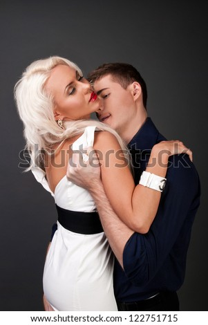 Man and woman blonde, love, feelings, sexy - the modern concept of love story. Hug of love and passion. Gentle kiss a sign of love. Sexy hug, stripping a woman's body. Men women love passion betrayal. - stock photo