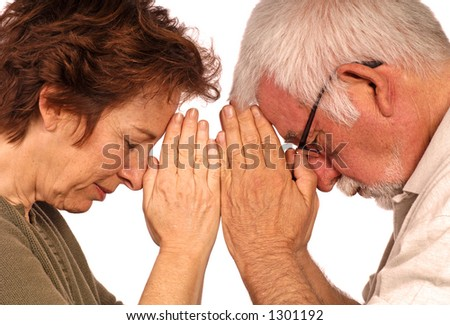 Man and woman bow to each other - stock photo