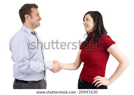 Man and woman business casual shaking hands - stock photo