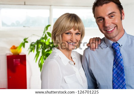Man and woman. Business couple posing together in their new office. - stock photo