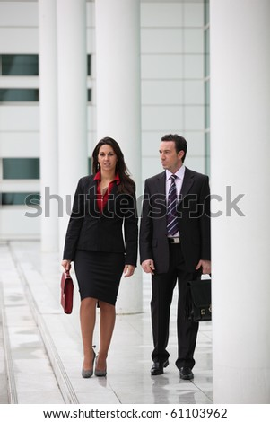 Man and woman business in the lobby of a company - stock photo