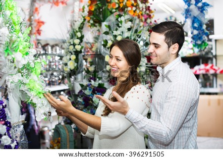 Man and woman buying a bouquet at a flower shop