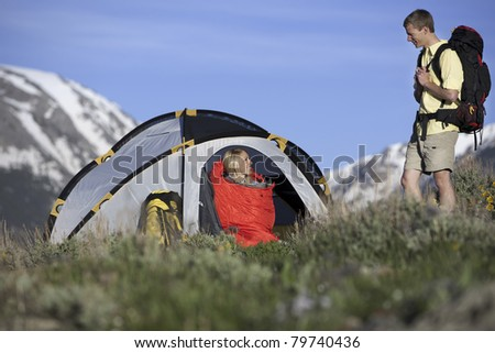 Man and woman camping in mountains in Colorado. - stock photo