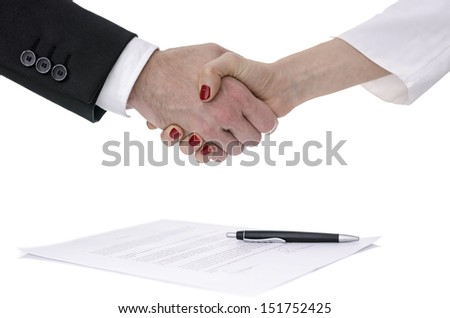 Man and woman congratulating with handshake after signing a contract.