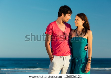 http://thumb7.shutterstock.com/display_pic_with_logo/84610/136036121/stock-photo-man-and-woman-couple-enjoying-the-romantic-sunset-on-a-beach-by-the-ocean-in-their-vacation-136036121.jpg