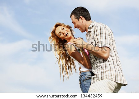 man and woman dance in the sky - stock photo