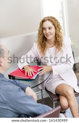 Man and woman discussing business in office - stock photo