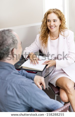 Man and woman discussing work in business office - stock photo