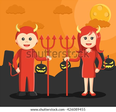 Man and woman dressed as a devil in halloween - stock photo