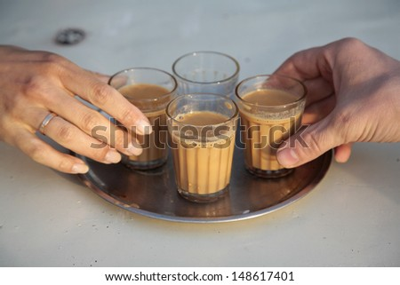 Man and woman drinking coffee on breakfast