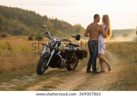 Man and woman embrace tenderly in the field. Love and sincere feelings. Beautiful young couple. Photo for social magazines, posters and websites. - stock photo