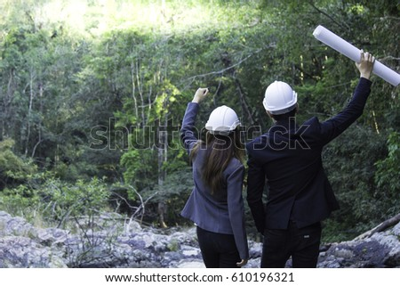 Man and Woman Engineer celebrate successful big project, Team work, Engineering working together.
