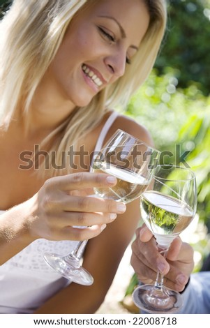 man and woman enjoying a rink or maybe a picnic outdoors - stock photo
