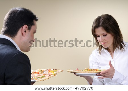 man and woman evaluating food