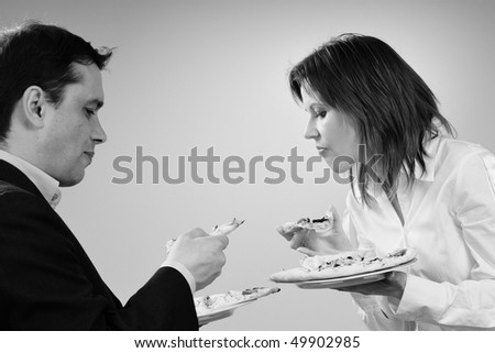man and woman evaluating pizza - stock photo