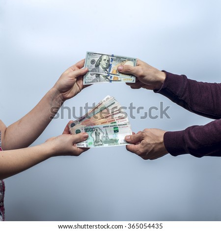 Man and woman exchange money