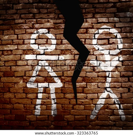 Man and woman figures painted on a wall with a crack between them - Divorce Concept                                - stock photo