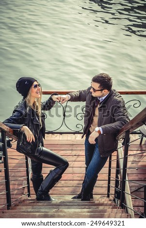 Man and woman fist bumping - stock photo