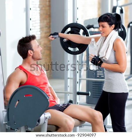 man and woman friends on sport fitness gym relaxed